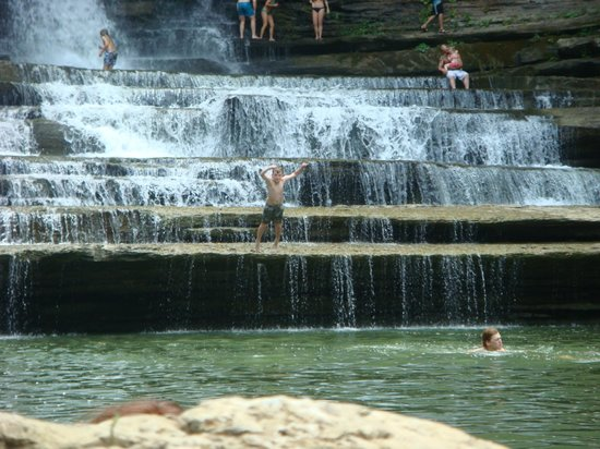 Cummins Falls State Park: falls. you can jump off into pool where the child that is front center is standing.