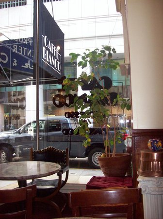 Caffe Bianco : View of interior column, table and window seating, looking out to Sutter St.
