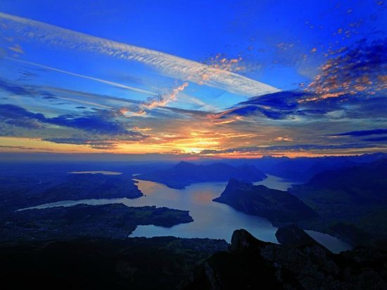 Zurich, Switzerland: Sunset on Mt. Pilatus during your overnight stay!