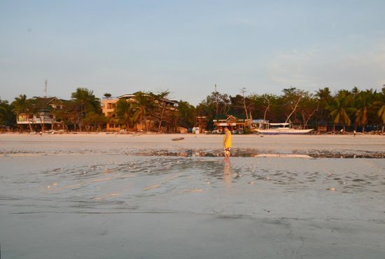 Dumaluan Beach Resort 2: View of the resort from the shore, at sunrise.