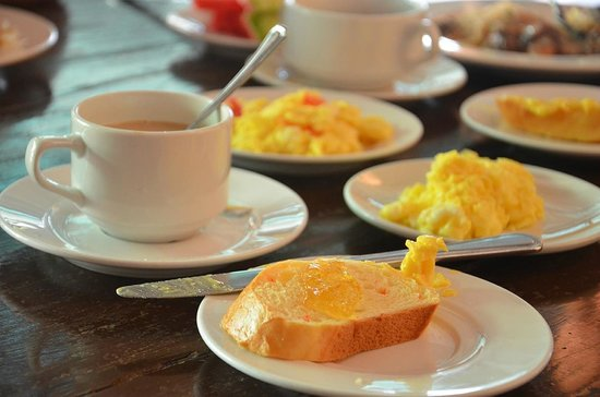 Dumaluan Beach Resort 2: From our first day buffet breakfast: butter and marmalade on carrot bread and Spanish omelettes