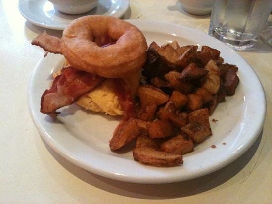 Uncle Betty's Diner: The Breakwich with added bacon. Yes, bacon and egg on a doughnut. With home fries.