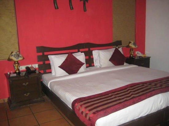 Lazylagoon Sarovar Portico Suites: Bedroom