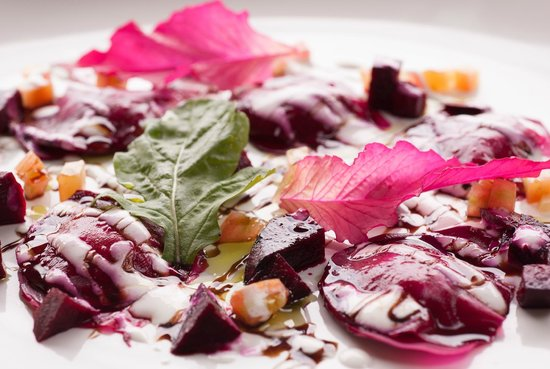 Karmaway: Beetroot ravioli with almond cheese filling and balsamic reduction