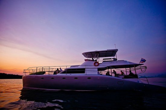 Epic Charters: The famous sunset at Nai Harn Beach