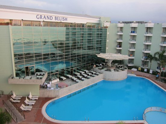 Grand Belish Hotel: Beside the pool is the restaurant, where the BBQ area is.