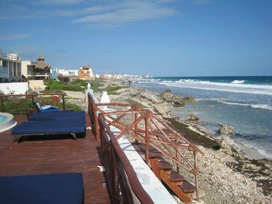 Casa Ixchel: hotel deck with stairs to the water and beach