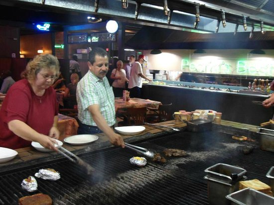 Alexander's Steakhouse: Steak and potato grilling