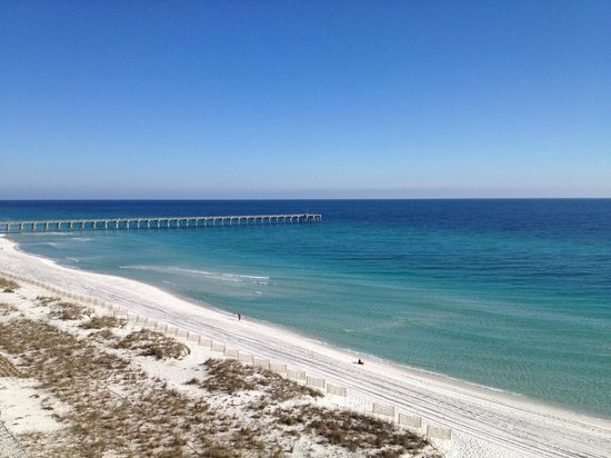 View of the blue water and white sand of Pensacola Beach.