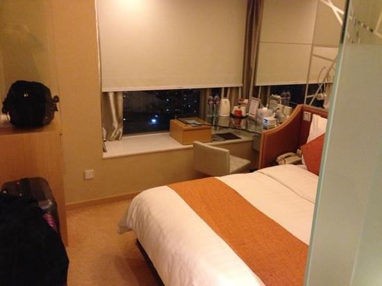 "Dorsett Mongkok Hong Kong: Walkway can fit two 28"" luggage. Electronic control by the bed for the blind"
