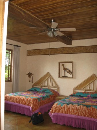 Lost Iguana Resort & Spa: the room for my brother & me. It was HUGE and beautiful....and certainly no fighting for space!