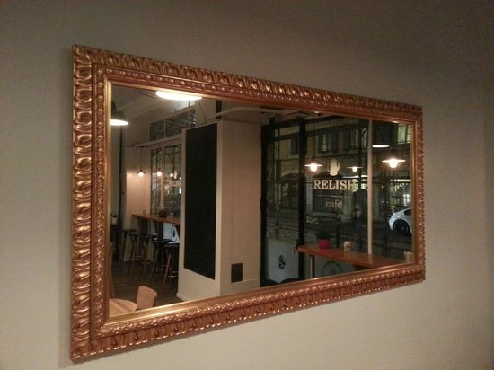 Relish Cafe: This particular mirror creates a mirror image of EVERYTHING you put in front of it...!!!