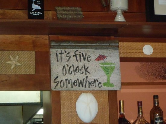 Ocean Club Cabana Bar & Grill: One of the signs behind the bar 