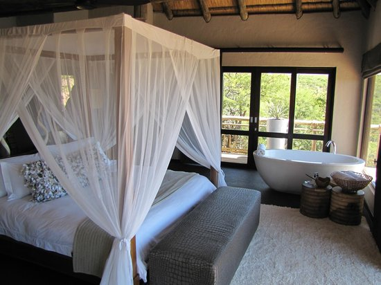 Nambiti Hills Private Game Lodge: A partial view of our room with a bath that overlooks the reserve