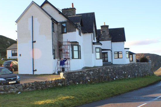 Bettyhill Hotel: The owner painting the new rendered exterior