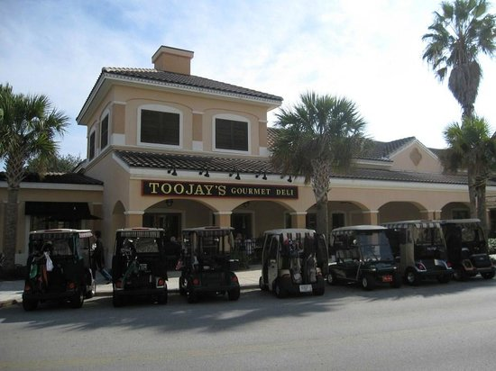 TooJay's: Retiree's golf carts line the streets along with the autos
