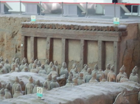 The Museum of Qin Terra-cotta Warriors and Horses: The warrior statues were walled in for eternity in front of this wall