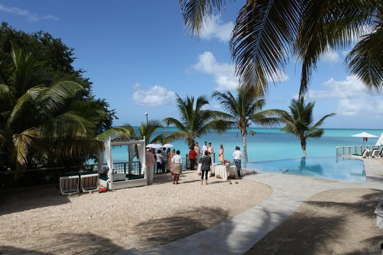 Cocobay Resort: Wedding by pool with beach in background
