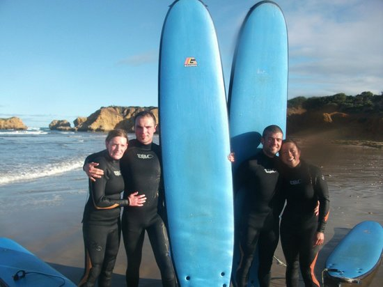 Torquay Surfing Academy: Happy group about to hit the water