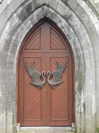 Yeats's Grave: Yeatsian swans on church door