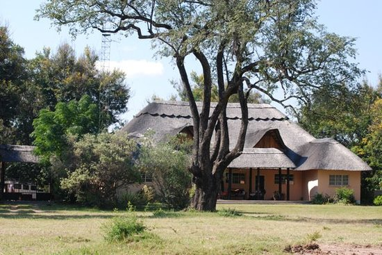 Bushbuck River House is set amongst mature trees and gardens on the banks of the Zambezi