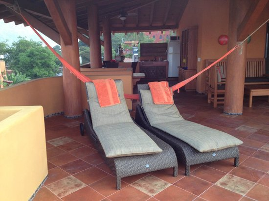 La Quinta de Don Andres : Lounge chairs and hammock on the terrace.