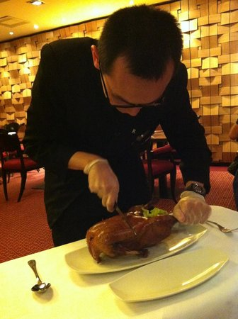 Asian Place : Cutting duck in front of you