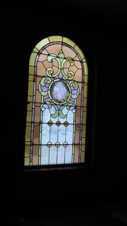 Ravenwood Castle: Cinderella's Coach House - stained glass windows in suite - GORGEOUS with the morning light!