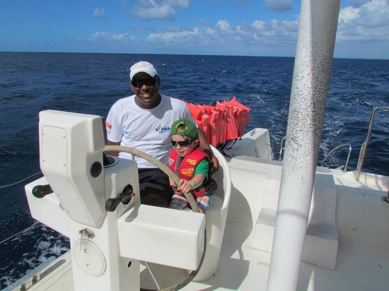 Grand Palladium Palace Resort, Spa & Casino: Seth piloting the catamaran to Saona