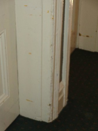 The Russell Hotel: banged up hall mouldings