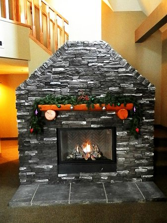 Banff Caribou Lodge & Spa: cozy gas fireplace in living room, stairs going to lofted bedroom & jacuzzi behind