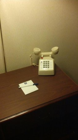 Comfort Inn at Maplewood: No, they aren't spying on you it is to show they clean the phones too.