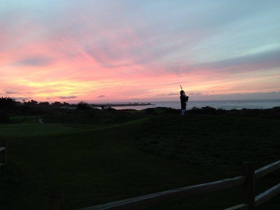 The Inn at Spanish Bay: Bagpiper at dusk.