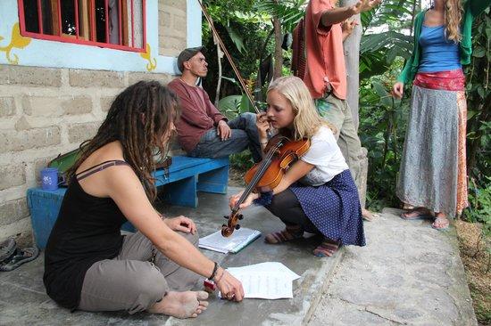 Mahadevi Ashram and Kaivalya Yoga School: Outside the rooms playing some music