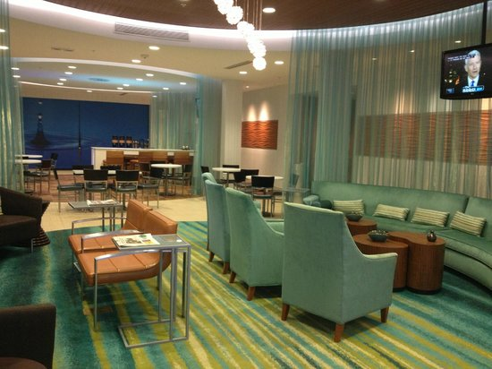 SpringHill Suites Houston The Woodlands: cool lobby; breakfast area at back