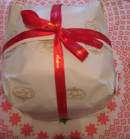 Panettone hand-wrapped in festive colours to look like a present