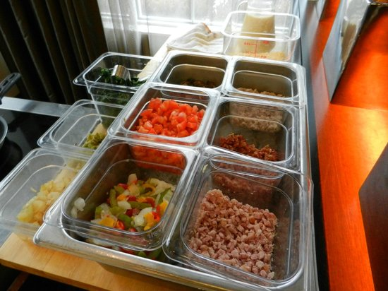 HYATT House Richmond-West: omelet station -onions,peppers,bacon,spinach,tomato,sausage,cheese, made to order, eggs or white