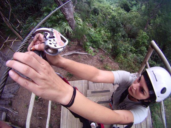 Big Island Eco Adventures II Zipline Canopy Tour: Ash hooking you up