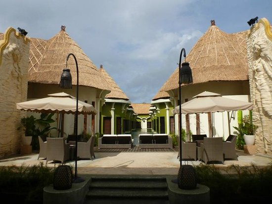 Villa Seminyak Estate & Spa: View from restaurant - Lagoon villa (2 storey) with common shared pool.