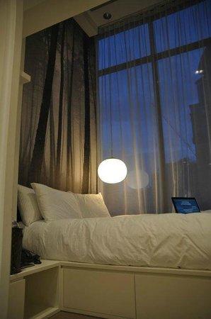 โรงแรมสตูดิโอเอ็ม: bed