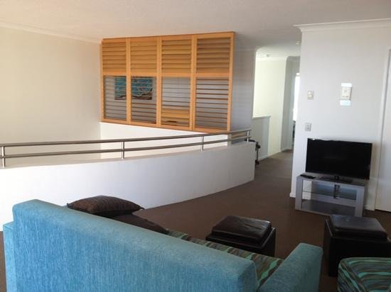Osprey Apartments : Apt 56, 2nd level living area with separate study area behind louvres, internal stairway behind