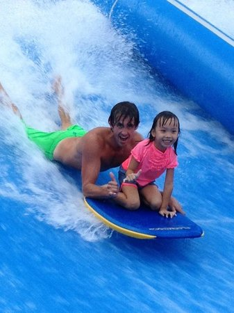 Flow House Bangkok: Qualified Wave Instructors to assist kids on the wave.