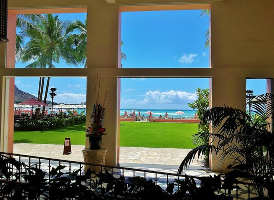 The Royal Hawaiian, A Luxury Collection Resort: View of Ocean and Pink Umbrellas