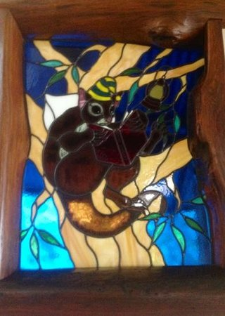 Secrets on the Lake: stained glass window in possums