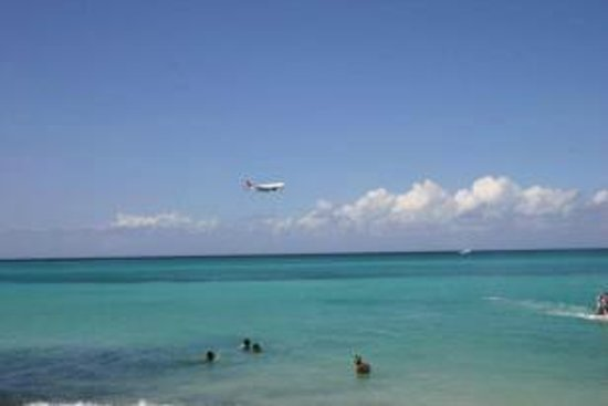 Sandals Carlyle Hotel View of public beach & air traffic