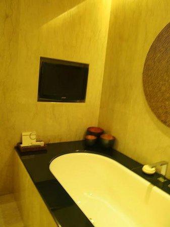 Conrad Bali: TV in bathroom