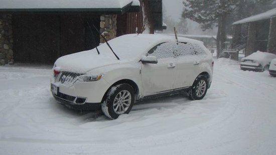 3 Peaks Resort and Beach Club: My Wifes new Lincoln covered in snow!