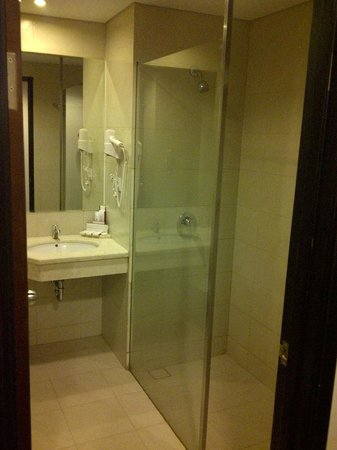Grand Clarion Hotel Convention Makassar Compact Bathroom With Shower And Closet