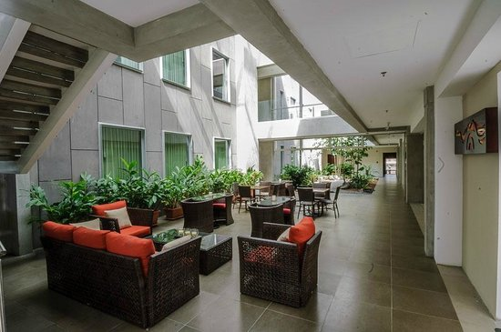 Isla Verde Hotel: Sala de Lobby con cafetería