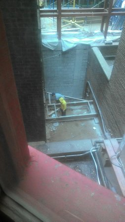 The Evelyn: Workers at about 6:45 am cutting a steel beam outside my window